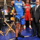 The Magic superduperstar unveiled of the league's saucy new on-court uniforms at the NBA Store in New York City.