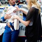 NASCAR's reigning Sprint Cup champ well knows that it's darned hard to concentrate on driving when you've got a tot squalling in the back seat for 300 miles. Here he wisely hands his baby daughter Genevieve Marie to his wife Chandra before the start of the Sylvania 300 at New Hampshire Motor Speedway.