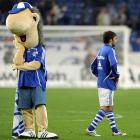 The following is the actual information that came with this photo. Please feel free to translate (maybe that's what the mascot is trying to do) : FC Schalke 04 Borussia Dortmund 1 3 Raul Gonzalez FC Schalke 04 and the Schalke Mascots Erwin are at Bottom destroyed Football men ger 1 BL 2010 2011 Gelsenkirchen Vdig  2010 horizontal Highlight Disappointment disappointed Highlights Highlight Feature Symbol image Symbolic imag.