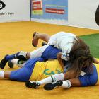 The ladies of Brazil's team formed a big ol' love pile after winning the final of the soccer event at Copacabana beach in Rio de Janeiro.