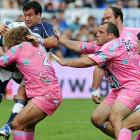 Apparently, streetwalkers play rugby -- at least that's what the caption that came with this photo strongly suggests:  Paris' hooker Dimitri Swarzewski (2) and prop Rodrigo Roncero (center) tackle Agen's hooker Brice Mach during their match at the Armandie Stadium in Agen, France.