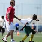 Still hobbled by his Achilles injury, the soccer icon was seen being towed around the pitch during a clinic for local players at the Marvin Lee Stadium in Macoya, Trinidad And Tobago. No word yet if FIFA or MLS will allow Becks to be towed in actual matches.