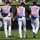 The three Rockies were a touching sight indeed as they held hands on their way to the bullpen with their matching princess-themed backpacks before a game against the Dodgers at Coors Field on Sept. 29. We hear there wasn't a dry eye in the house.