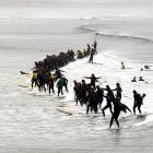 No, it's not a recreation of the D-Day invasion of Normandy. A reported 95 intrepid souls tried to break the Guinness World Record for most surfers on a single wave (103) at Muizemberg beach on the outskirts of Cape Town, South Africa, on Sept. 23.