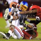 San Jose State quarterback Jordan La Secla is sacked by Alabama's Robert Lester, bottom, and Chris Jordan during the Tide's resounding victory.