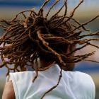 Dustin Brown of Jamaica in action during his loss to Great Britain's Andy Murray in the second round at the U.S. Open.