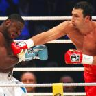 Ukrainian heavyweight champion Wladimir Klitschko lands a punch on challenger Samuel Peter of Nigeria during their WBO and IBF World Championship bout on Sept. 11 at the Commerzbank Arena in Frankfurt, Germany. Klitschko won with a TKO in the 10th round.