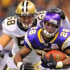 Minnesota Vikings running back Adrian Peterson is chased by Scott Shanle during the New Orleans Saints 14-9 victory in both team's season opener on Sept. 9 in New Orleans.