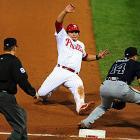 Carlos Ruiz of the Philadelphia Phillies slides into third before the ball reaches Martin Prado during the Phillies 1-0 win over Atlanta on Sept. 22.