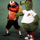 It's impossible to tell whether this is a prelude to a rumble or a dance-off.  Either way, both the Baltimore Oriole Bird and the Phillie Phanatic look focused and well-prepared.
