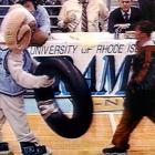 As earlier noted, you don't remove a mascot's head during the course of play.  The University of Rhode Island mascot, Rhody, learned this the hard way after he knocked the face mask off the St. Joseph's mascot.  In this image taken from television, the Hawk seeks his revenge.