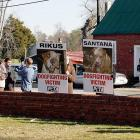 Protesters hold signs outside Surry County Circuit Court where Vick pled guilty to two felony counts connected to dog fighting.