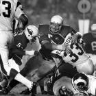 St. Louis Cardinals defensive tackle Bob Rowe wraps up Los Angeles Rams running back Willie Ellison during a Week 1 showdown in the L.A. Coliseum. Cardinals' defenders had a hard time bringing Rams' rushers to the ground in their Sept. 18 contest, allowing them to scamper for 157 yards in a 34-13 Los Angeles victory.
