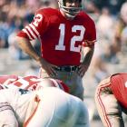 A San Francisco 49er for his entire 16-year career, quarterback John Brodie sets himself during an early season game against the Cleveland Browns. Brodie torched defenses in 1970, throwing for a league-leading 2,941 yards and 24 touchdowns in his first and only MVP season.