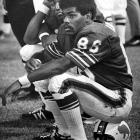 The first black quarterback ever to start a game in the NFL, Marlin Briscoe switched positions to become a wide receiver after joining the Buffalo Bills in 1969. That move paid major dividends in 1970, as Briscoe finished second in the league with 1,036 receiving yards. Here, he finds a comfortable seat atop his helmet during a 35-20 victory over the Philadelphia Eagles.