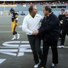 Head coaches Bart Starr of the Green Bay Packers (left) and Chuck Noll of the Pittsburgh Steelers shake hands after their teams collided in Three Rivers Stadium. The coaches faced off three times over the course of their careers, with Noll's Steelers emerging victorious in all three.