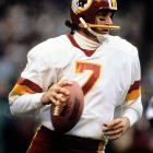 Washington Redskins quarterback Joe Theismann sets to pass. After starting the season 3-9 as a starter, Theismann led Washington to three straight victories to end the year. The success didn't translate to next season though, as the Redskins began their 1981 campaign 0-5.