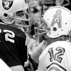 Houston Oilers quarterback Ken Stabler (right) talks to Oakland Raiders defensive end John Matuszak before their AFC playoff matchup. The Raiders all-time leader in passing yards, touchdowns and completions, Stabler was traded to the Oilers before the 1980 season, following a lengthy contract dispute.