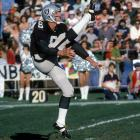 Oakland Raiders kicker Ray Guy punts during the team's 27-7 playoff win over the Oilers. The first punter ever selected in the first round, Guy averaged under 40 yards per punt only once during his 14 years in the league and had only three of his 1,049 career punts blocked.