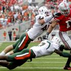 Despite four Jacory Harris interceptions, Miami kept it interesting right until the end. Ultimately, Dan Herron (1), Terrelle Pryor and the Ohio State offense did enough to secure the win on a rainy day in Columbus.