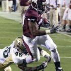 Mississippi State can still privately celebrate last week's landmark victory over Florida ... now that it has survived a scare against lowly UAB. Tailback LaDarius Perkins paced the Bulldogs with 135 total yards (131 rushing) and two touchdowns.