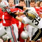 Maybe Ohio State isn't finished after all. The Buckeyes got over their Wisconsin hangover in a hurry, dismantling the Boilermakers in a 49-0 win. Dan Herron got things started with two early touchdowns, and the Ohio State defense kept Purdue under 100 total yards until the Boilermakers' final possession of the game.
