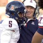 Coach Mike Stoops and Shequile Richardson enjoy a few stress-free moments in the Wildcats' hard-fought win in Spokane. Arizona has clashes with Washington and UCLA before its Nov. 6 showdown with Stanford.