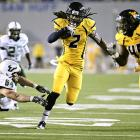 West Virginia's offense was sluggish for most of the night, but the defense picked up the slack. The Mountaineers held South Florida to 202 total yards and no touchdowns while sacking Bulls quarterback B.J. Daniels four times and intercepting three of his passes, including Robert Sands' (2) momentum-changing pick just before the half.