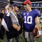 Peyton's little bro, who knows a thing or two about takin' a beatin' before a national television audience, consoled his counterpart after Eli's mean old Giants opened  a can of Whoop-Ass  on Romo's Cowboys in Arlington, Texas, on Monday night.