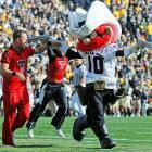 The Texas Tech mascot broke out the shootin' irons before a game against the Colorado Buffaloes and no doubt sent the crowd diving for cover. Amazing that he was able to get those things into the stadium.
