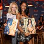 What sports connection could gin mill matrons Rachel and LeAngela possibly have? We direct your attention to the swimsuits in the photos they're holding at a Hooters in New York City. 'Nuff said.