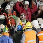Being trapped in a copper mine for two months didn't dim the enthusiasm of Mario Sepulveda Espina (center), who upon his rescue immediately led the crowd in a boisterous cheer that would have made any team's rabble-rouser green with envy.