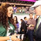 The songbird and the Jets owner discussed the finer points and many uses of photography before Brett Favre's return to the Meadowlands on Oct. 11.