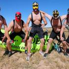 """The aptly-named H.E.L.L. Riders (Hermanos En Lucha Libre or """"Happy Funny Farm Escapees"""") paused to do their best  Mr. Gumby  impressions before the start of the 7,000-lap, 14.9-mile mountain bike race in Moab, Utah, on Oct. 9."""