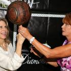 The grand dame of women's hoops (right) showed the Bionic Woman a trick of her trade at the Diamond in the RAW Foundation's Third Annual Celebrity and Stuntwomen's Awards in Los Angeles.