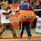 Roc the Pittsburgh Panther mascot has obviously taken  the self-defense against fruit course [click here]  as he demonstrated the proper form when pitted against Otto the Orange in a juicy battle at Syracuse's Carrier Dome.