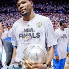 Durant stands with the trophy following the Thunder's victory over the Spurs in Game 6 of the Western Conference Finals.
