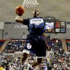 UConn's Jerome Dyson lets out a scream as he dunks in front of the Gampel Pavilion crowd during the Huskies' 2008 Midnight Madness.