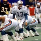 The greatest quarterback never to win a Super Bowl, Dan Marino barks out play calls to his team during a Nov. 8 game against the Cincinnati Bengals.  The Hall of Fame signal-caller tossed for 3,245 yards in 1987, a total that ranked fourth in the NFL.