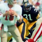 Steelers' safety Donnie Shell eyes down Joe Montana during their Week 1 matchup.  The vaunted Pittsburgh defense got the best of Montana, forcing him to throw three interceptions in a 30-17 San Francisco defeat.  It was the 49ers who got the last laugh, though, as they won 13 of their final 14 to finish a league best 13-2 during the regular season.