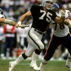 A defensive force during his 13 years on the line for the Raiders, Howie Long barrels upfield during a Week 15 matchup with Chicago.  The Oakland defense proved to be a formidable test for the explosive Bears' offense, holding Walter Payton, Mike Tomczak and Co. to a measly six points.  Unfortunately for Long, the Los Angeles offense could only muster a field goal in response as Chicago triumphed 6-3.