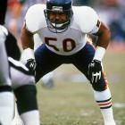 """One of the revered """"Monsters of the Midway,"""" linebacker Mike Singletary readies himself during their Dec. 27 showdown with the Los Angeles Raiders.  Singletary's defense would key a 6-3 Chicago win, propelling the Bears into a divisional playoff game against the Washington Redskins on Jan. 10.  The Bears weren't as fortunate in that contest, losing 21-17."""