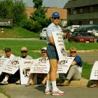 Redskins' quarterback Jay Schroeder stands with a placard during the 1987 players' strike.  Washington's leading man had an up-and-down season for the team, starting only 10 games because of a shoulder injury that nagged him throughout the year.  That opened the door for Doug Williams to become the starter before the team's eventual Super Bowl run, and a discarded Schroeder was traded to the Raiders in the subsequent offseason.