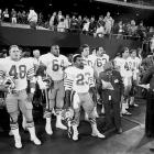 """Jokingly dubbed the San Francisco """"Phoney-Niners,"""" replacements Mike Varajon (48), Michael Durrette (64) and Tony Cherry (23) prepare to take the field before a game against the New York Giants in Week 3.  The replacements fared well in their Monday Night contest, knocking off what remained of the defending champs 41-21.  San Francisco didn't miss a beat during the 1987 players' strike, winning all three games that its stars missed."""