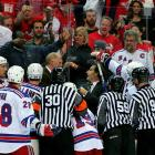 "During a 4-0 first round playoff game loss to the Capitals in Washington, the fiery coach of the New York Rangers erupted at taunting fans behind his team's bench.  Tortorella squirted water over the glass, threw the water bottle -- hitting a woman in the stands -- and brandished a stick.  . ""While it is a difficult decision to suspend a coach at this point in a playoff series, it has been made clear to all of our players, coaches and other bench personnel that the National Hockey League cannot -- and will not -- tolerate any physical contact with fans,"" NHL Director of Hockey Operations Colin Campbell said in a statement announcing that Tortorella would sit out the Rangers' next game.    CLICK HERE  to watch the video."