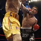 Margarito became a two-time world titlist with a thrilling sixth-round knockout of Cintron, who'd gained the IBF welterweight belt since their first meeting.