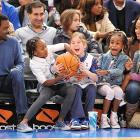 Chris Rock, spouse Malaak and their rollicking offspring got their jollies at a Knicks-76ers game in New York. We believe those are the Rolls sitting behind the Rocks ...