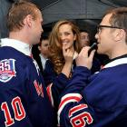 The saucy swimsuit model's got quite a choice of dreamboats, eh? It's either the Rangers' vaunted and gentlemanly sniper (left) or their notorious fashion plate/pot-stirrer (right). All the drama went down at the team's 85th anniversary jersey unveiling at The Rink at Rockefeller Center in New York City.