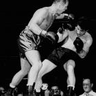 Known famously as the Man of Steel, Zale ( left ) regained the middleweight title with a third-round knockout in the rubber match of a legendary trilogy with Rocky Graziano.
