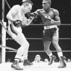The aggressive counterpuncher met Gene Fullmer at San Francisco's Candlestick Park for the WBA middleweight title that was vacated when Paul Pender retired. Tiger ( right ) decisioned Fullmer for the belt and the pair fought to a draw four months later. Not until a seventh-round TKO of Fullmer in December 1963 did Tiger earn recognition as lineal champion.